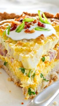 Loaded Potato Quiche ~ It's absolutely packed with flavor. The filling is made from hash browns, savory ham, sharp Cheddar cheese, green onions, eggs, and perfectly crispy bacon... Made easy with a quick Bisquick crust!