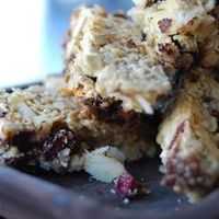 Granola Bars. Ingredients 3 cups quick-cooking oats 1 (14 ounce) can sweetened condensed milk 2 tablespoons butter, melted 1 cup flaked coconut 1 cup sliced almonds 1 cup miniature semisweet chocolate chips 1/2 cup sweetened dried cranberries Dire...