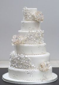 White Ruffles, Swarovski and Diamond Flowers Wedding Cake