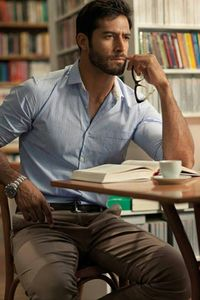Choose a baby blue gingham dress shirt and brown chinos for a seriously stylish look.