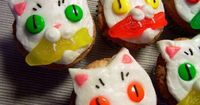 These cookies look easy to make, no recipe is provided but I bet if you take an oatmeal or sugar cookie and ice and decorate with candy you could get these results!