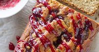 Banana bread goes back to school with a peanut butter twist and a raspberry jam swirl in this Peanut Butter and Jelly Banana Bread Recipe.