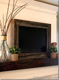 Frame a wall mounted TV. This is for above a mantle. I see it as a fireplace screen. Now THIS I could see in our living room! Showing this to my husband. I've built one fireplace, I can build another!