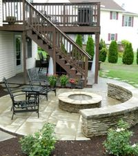 Paver patio under deck and side patio with stone veneer firepit and sitting wall, I love this idea!