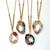 earthy geode slice with a brass wheat chain. $38.00, via Etsy.