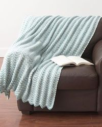 Free crochet pattern - An elegant ripple pattern crocheted in dreamy blue and cream shades makes this blanket a cozy and calming addition to any room. Shown in Bernat Denimstyle.