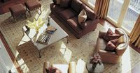 A bird's-eye view of this large living space shows how a room-size rug helps to bridge separate seating spaces.
