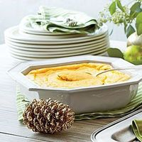 This recipe for Cheesy Grits Soufflé turns a classic Southern dish into a light, fluffy soufflé for the ultimate holiday brunch.