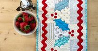 Follow this Free Christmas table runner quilt pattern from Quilting Focus to make your own fun, modern and festive Christmas centrepiece!