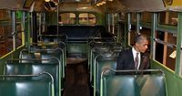 Obama in sits in the seat of Rosa Parks