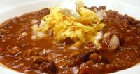 Slow Cooker Chili 1 lb. hamburger meat 1 can pink beans (drained and mashed) 1 can red beans (drained and mashed) 1 (large) can diced tomatoes 1-2 onions, diced 1 red pepper, diced 1 McCormick Chili Seasoning Packet Extra Chili Pow...