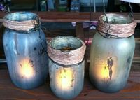 These are our Pumpkin Rot inspired lanterns. Using Dollar Tree flickering, battery operated tea lights to illuminate. Our next series is going to try a silver, metal spray paint on the exterior and while wet, misting it with a vinegar/water solution. Usin...