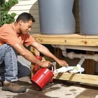This DIY rain barrel costs less than $100 and works just as well as the expensive one you can buy. Get complete how-to instructions and start saving water with