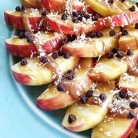 Sliced honey crisp apples + paleo caramel + almond butter mixed with coconut milk & honey to thin + raw shredded coconut + mini chocolate chips! A Whole Family