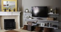 Cool idea for the tv. Cords for the electronics are tucked away in the basket