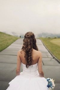 We love this bride's pretty rosette in the back of her hairdo!