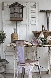 Rustic & pretty, but the rusty chair is impractical, as it would snag clothing. To preserve the authenticity of the vintage paint, the chair could be slipcovered to make it usable--if used indoors. This seems to be a shabby chic outdoor vignette, in w...