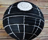 Having a Star Wars party? Here's how to have your own Death Star Paper Lantern!Materials: Glue, Scissors, Black Table Napkin, Black Permanent Marker & Printab..