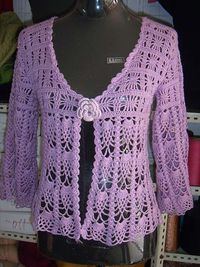 sweater with spider and pineapple motifs