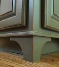 "Making kitchen cabinets look like furniture by adding decorative corner ""legs"""