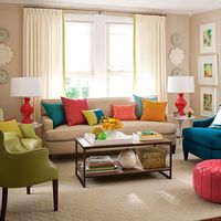 colorful living room, green chair, blue chair, coral lamps