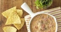 Chorizo sausage gives this crock-pot dip a different flavor--sure to be a hit at your next party.
