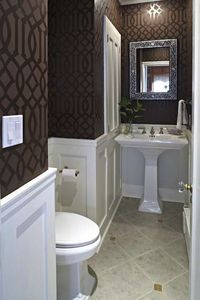 Tiny bathroom. Wainscoting and strategic use of dark and light make room look larger. Base coat it matte, stencil is high gloss.