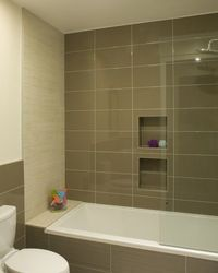 I love these large tiles, but refer them to be often (typical subway tiles) rather than a grid like the photo.
