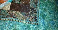Turquoise & Brown quilt, corner detail and backing fabric. I like the print binding; it adds another dimension to the quilt.