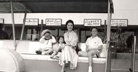 Shirley Temple with her children at Disneyland, 1950s