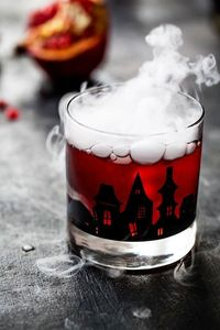 Pomegranate Ginger Punch is a goblin brew perfect for your grown-up Halloween party. It packs a delicious punch - pun intended! #halloween #drinks
