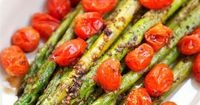 Roasted Asparagus and Tomatoes - takes one minute to toss together and is ready to eat in 15 minutes! SO quick and easy!! Asparagus,grape tomatoes, olive oil, b