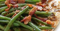 This quick and easy chicken dish is cooked in a white wine sauce with string beans and bacon, all in one skillet. You can modify this basic recipe using any veg