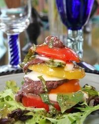Stacked Tomato Salad with Black Olive Tapenade and Sweet Basil Dressing
