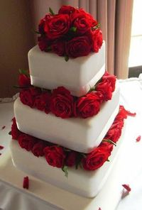 perfect wedding cake! with the red roses in between the layers of cake.