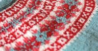 The colors are lovely and I love the little xoxoxo! fibrearts: Red and Blue by handepande