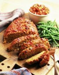 This is a basic crockpot meatloaf made with ground beef and seasoned with ketchup and chopped vegetables.
