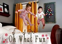 Jumping on the bed Christmas Card. Precious little ones captured in holiday spirits