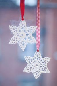 crochet snowflakes, red ribbons and crochet christmas.