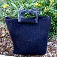 This Felted Tote is a stylish purse pattern that is great for beginners. This simple tote tutorial shows you how to make a bag using basic knitting techniques s