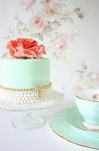 Pale blue and pink rose cake
