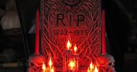 DIY RIP Tombstone made using a string of flickerlights [sold for Christmas]. Nice addition the the graveyard scene! #yardhaunt
