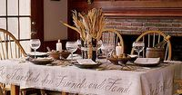 Dressing Your Thanksgiving Table - love the calligraphy on the side of the table cloth
