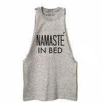"Crack up your yoga class in one of these cute and comfy tank tops that feature hilarious spins on traditional yoga mantras, like ""Namaste in Bed,"" ""Let's Get It"