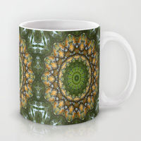 nature inspired kaleidoscope mug with green, gold and brown.
