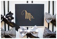 A dapper boy first birthday party bow tie bar! Black Matte Paper with Gold Calligraphy. Bow ties for each boy guest. Grey, White, and Black inpoststripes, polkadots.