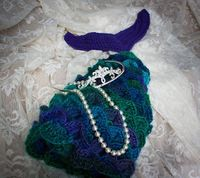 Crocheted Mermaid Photo Prop (free pattern): Red Heart's Boutique Unforgettable is truly my new favorite yarn. I always cringe at buying fancy schmancy yarns, but this one was worth every penny. I am hooked! *groan* I did include the notes I w...