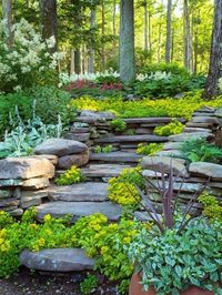 Would love to do something like this going down to our mailbox..never gonna happen. Can't even imagine where you would get stone slabs like that and how much they would cost if you found them :P.