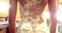 The most amazing back detailing on this wedding dress! only pinning because of how gorgeous it is, even though I don't want it for my own dress.