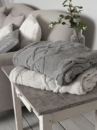 Ben-Chynna Warner Those blankets, lined with soft material on one side--I WANT those! Love the cable knit look!!!! I need to keep learning to knit!